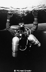 Tech diver with 2 stage tanks under the ice in Morrison's... by Michael Grebler 